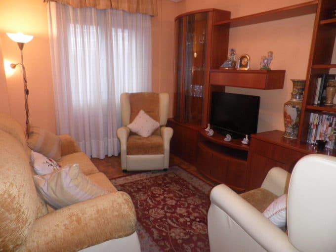 Foto de la sala del piso en Reyes Católicos a la venta en Trivinsa inmobiliaria